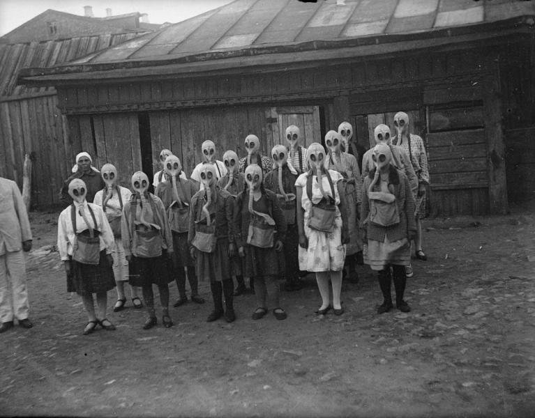 Absolutely terrifying: Group of girls wear their gas-masks during a gas drill. Moscow, 1930s