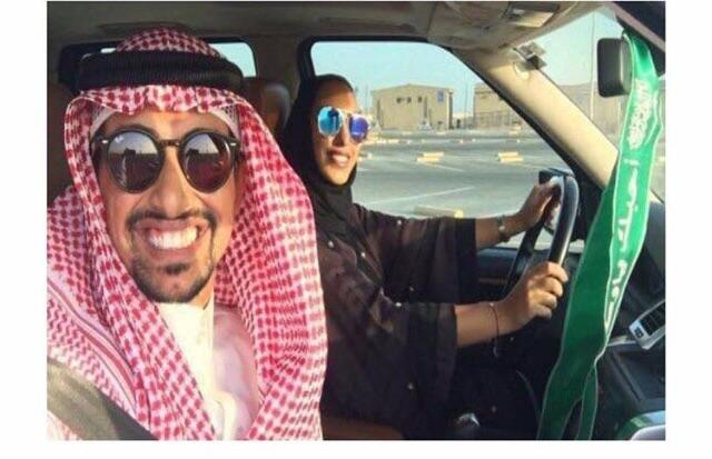 A pic of a Saudi man teaching his wife to drive