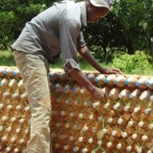 Constructing A House From Recycled Bottles